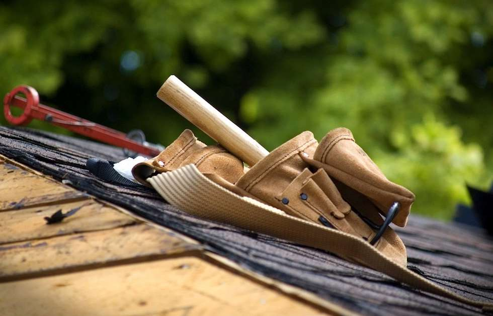 roof replacement tools on shingled roof