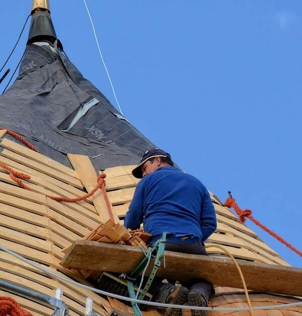 Portland roofer installing new shingles on roof